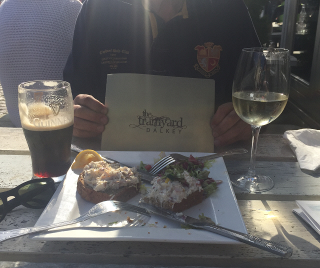 Open crab sandwich, Guinness and white wine in the sunshine - The Tramyard, Dalkey